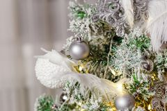 White and silver balls on Christmas tree. Merry Christmas stock photography