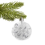 2015 on a white silver Christmas ball hanging on a tree Royalty Free Stock Image