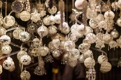 White and silver christmas tree ornaments and balls, advent market stall close up, photo stock photo