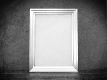 White silver frame in abandoned interior. Vintage silver frame in old interior Royalty Free Stock Photo