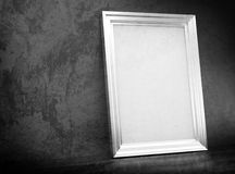 White silver frame in abandoned interior. Vintage silver frame in old interior Royalty Free Stock Image