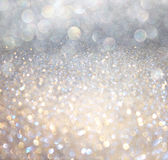 White silver and gold abstract bokeh lights. defocused background. White silver and gold abstract bokeh lights royalty free stock photo