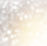 White silver and gold abstract bokeh lights. defocused background Stock Images