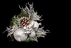 White, silver and green Christmas Ornament with pine cone. Isolated on black royalty free stock images