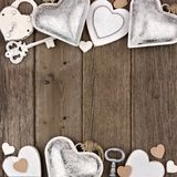 White and silver hearts double border on rustic wood Royalty Free Stock Photo