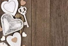 White and silver hearts side border on rustic wood Royalty Free Stock Photos