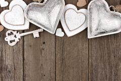 White and silver hearts top border on rustic wooden Stock Image