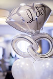 White and silver mylar engagement balloon that says,. `I do` at an engagement party Stock Photos