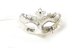 White and Silver Ornate Masquerade Mask on White Background Stock Photo