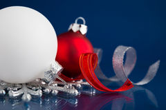 White, silver and red christmas ornaments on dark blue background Stock Photo