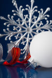 White, silver and red christmas ornaments on dark blue background Stock Image