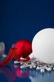 White, silver and red christmas ornaments on dark blue background Stock Images