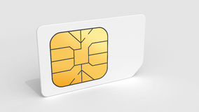 White Sim card on light gray background Royalty Free Stock Images