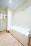 White simple clean bath in light and empty bathroom. With towels Stock Images