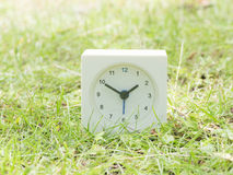 White simple clock on lawn yard, 1:50 one fifty Stock Photo
