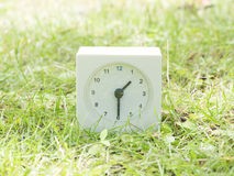 White simple clock on lawn yard, 1:30 one thirty half Royalty Free Stock Photos