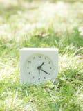 White simple clock on lawn yard, 1:20 one twenty Royalty Free Stock Photos