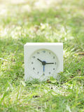 White simple clock on lawn yard, 10:15 ten fifteen Stock Images