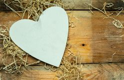 I love you - white, simple heart cut from wood on a romantic, simple rustic background, with space for text. White, simple heart cut from wood on a romantic stock photo