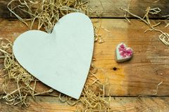 I love you - white, simple heart cut from wood on a romantic, simple rustic background, with space for text. White, simple heart cut from wood on a romantic stock photography