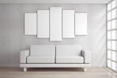 White Simple Modern Sofa Furniture under Blank White Poster. 3d. White Simple Modern Sofa Furniture under Blank White Poster in front of brick wall. 3d Rendering Stock Photo