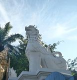 White Singha guarding temple entrance. Lion the guardian Northern style at Wat Phra Singh , Chiangmai , Thailand Stock Photography