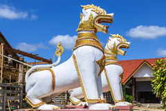 White singha statue standing protection in thai te Royalty Free Stock Photography