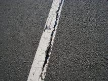 White line and asphalt crack royalty free stock photo