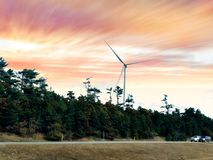 A white single wind generating by the highway royalty free stock photo