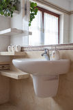 White sink. Vertical view of white sink in bathroom Royalty Free Stock Images