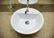 White sink. In bathroom 2 Royalty Free Stock Images