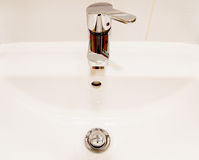 White sink and chrome faucet with handle Stock Photos