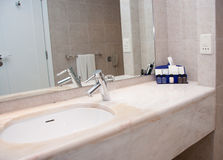White sink with chrome tap Royalty Free Stock Photo