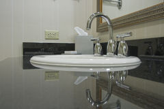 White sink with chrome taps Stock Photos