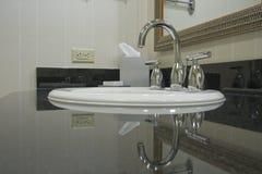 White sink with chrome taps stock photos