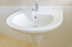 White sink and faucet in a bathroom Stock Photography