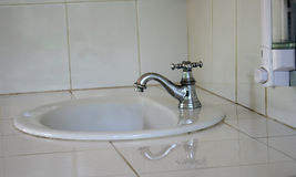 White sink and faucet Royalty Free Stock Image