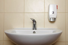 White sink and tap in the bathroom Stock Photo
