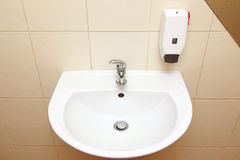 White sink and tap in the bathroom Royalty Free Stock Photo