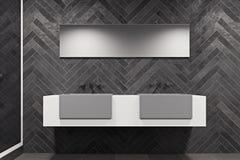 White sink vanity unit in a black bathroom Stock Photos