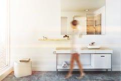 White sink vanity unit in loft bathroom, woman stock photo