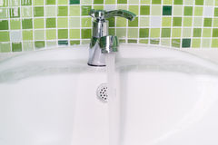 White sink washbasin and silver faucet Royalty Free Stock Photo
