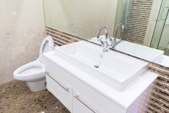 White sink washbasin and silver faucet Stock Photography