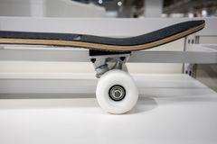 White skateboard wheel on white shelf for display stock photo