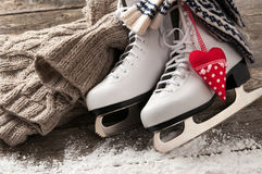 White skates on old wooden boards. White ice skates on old wooden boards royalty free stock photo