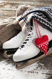 White skates on old wooden boards. White ice skates on old wooden boards royalty free stock photography