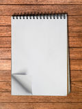 White sketch book one page Vertical on Wood Royalty Free Stock Images