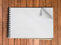 White sketch book one page on Wood Royalty Free Stock Image