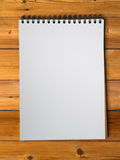 White sketch book on wood Royalty Free Stock Photography
