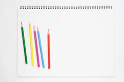 White sketchbook and color pencils Stock Image